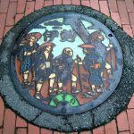 Pilgrims on a man hole in Ise